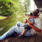 My lil man and his first fish at one year old josh and brentley