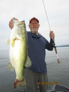 Mr. Greg Ballard of Birmingham AL with a 8 pound Largemouth caught during the 2012 Shad Spawn on Lake Guntersville using a Assassinator Clacker Spinnerbait